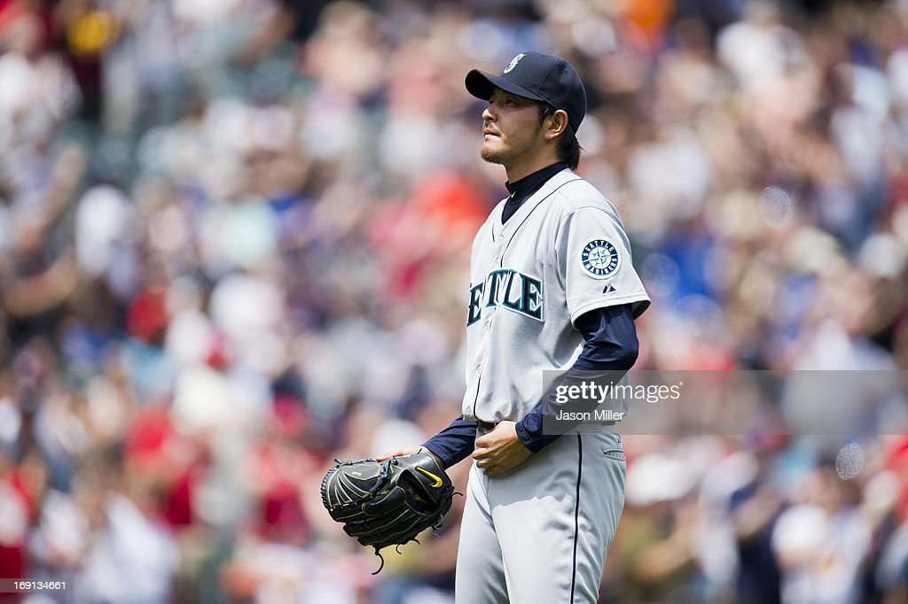 Starting pitcher <a gi-track='captionPersonalityLinkClicked' href=/galleries/search?phrase=Hisashi+Iwakuma&family=editorial&specificpeople=5723798 ng-click='$event.stopPropagation()'>Hisashi Iwakuma</a> #18 of the Seattle Mariners reacts to giving up two home runs during the second inning against the Cleveland Indians at Progressive Field on May 20, 2013 in Cleveland, Ohio.
