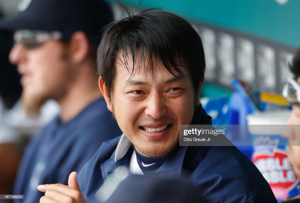 Starting pitcher Hisashi Iwakuma #18 of the Seattle Mariners smiles in the dugout during the game against the Los Angeles Angels of Anaheim at Safeco Field on April 28, 2013 in Seattle, Washington. The Mariners defeated the Angels 2-1.