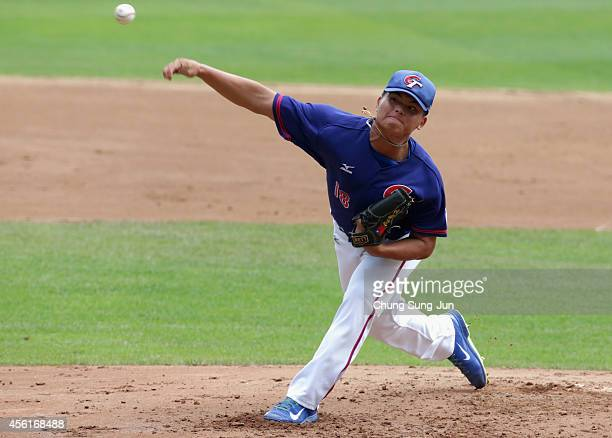 Starting pitcher Hu Chih Wei of Chinese Taipei throws in the bottom of first inning during the Baseball Semifinal match between Japan and Chinese...