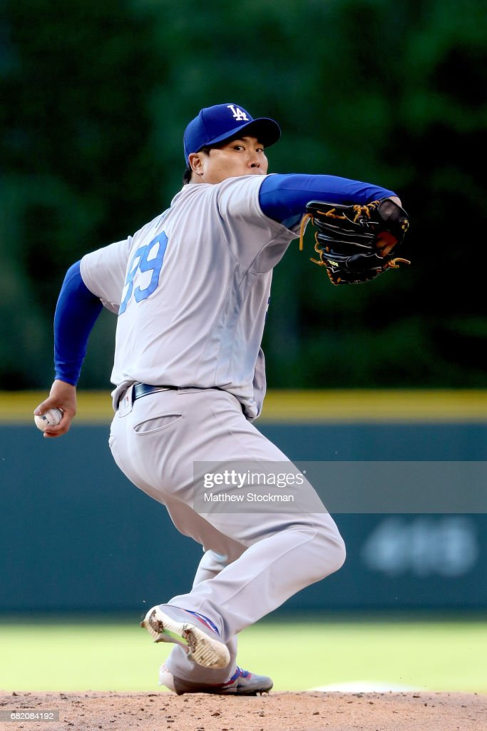 Starting pitcher Hyun-Jin Ryu #99 of the Los Angeles Dodgers throws in the first inning against the Colorado Rockies at Coors Field on May 11, 2017 in Denver, Colorado.