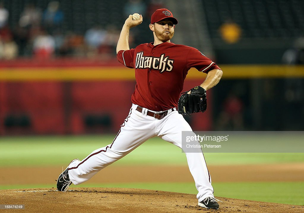 Starting pitcher Ian Kennedy #31 of the Arizona Diamondbacks pitches against the Colorado Rockies during the MLB game at Chase Field on October 3, 2012 in Phoenix, Arizona.