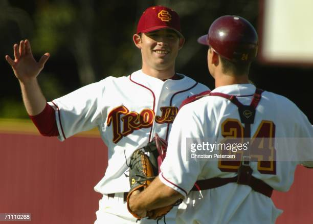 Starting pitcher Ian Kennedy of the USC Trojans celebrates with catcher Jeff Clement after defeating the UCLA Bruins in the game held at Dedeaux...