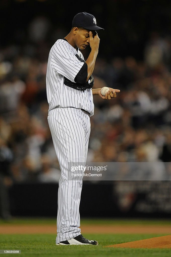 Starting pitcher <a gi-track='captionPersonalityLinkClicked' href=/galleries/search?phrase=Ivan+Nova&family=editorial&specificpeople=5743486 ng-click='$event.stopPropagation()'>Ivan Nova</a> #47 of the New York Yankees rubs his forehead as he gets set to throw a pitch against the Detroit Tigers during Game Five of the American League Championship Series at Yankee Stadium on October 6, 2011 in the Bronx borough of New York City.