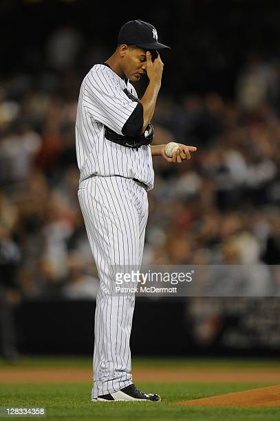 Starting pitcher Ivan Nova of the New York Yankees rubs his forehead as he gets set to throw a pitch against the Detroit Tigers during Game Five of...