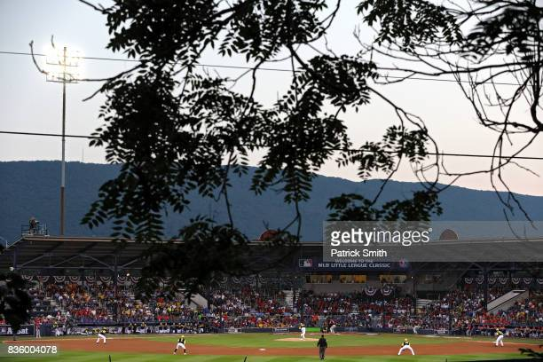 Starting pitcher Ivan Nova of the Pittsburgh Pirates works a St Louis Cardinals batter in the inaugural MLB Little League Classic at BBT Ballpark at...