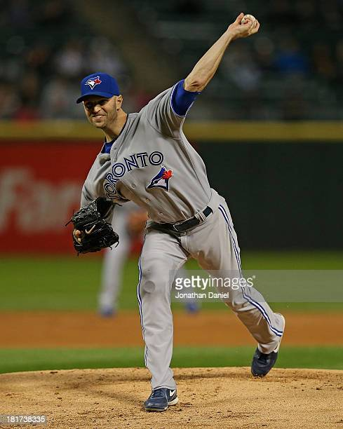 Starting pitcher JA Happ of the Toronto Blue Jays delivers the ball against the Chicago White Sox at US Cellular Field on September 23 2013 in...