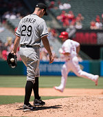 Starting pitcher Jacob Turner of the Chicago White Sox reacts as Albert Pujols of the Los Angeles Angels of Anaheim runs the bases after hitting a...