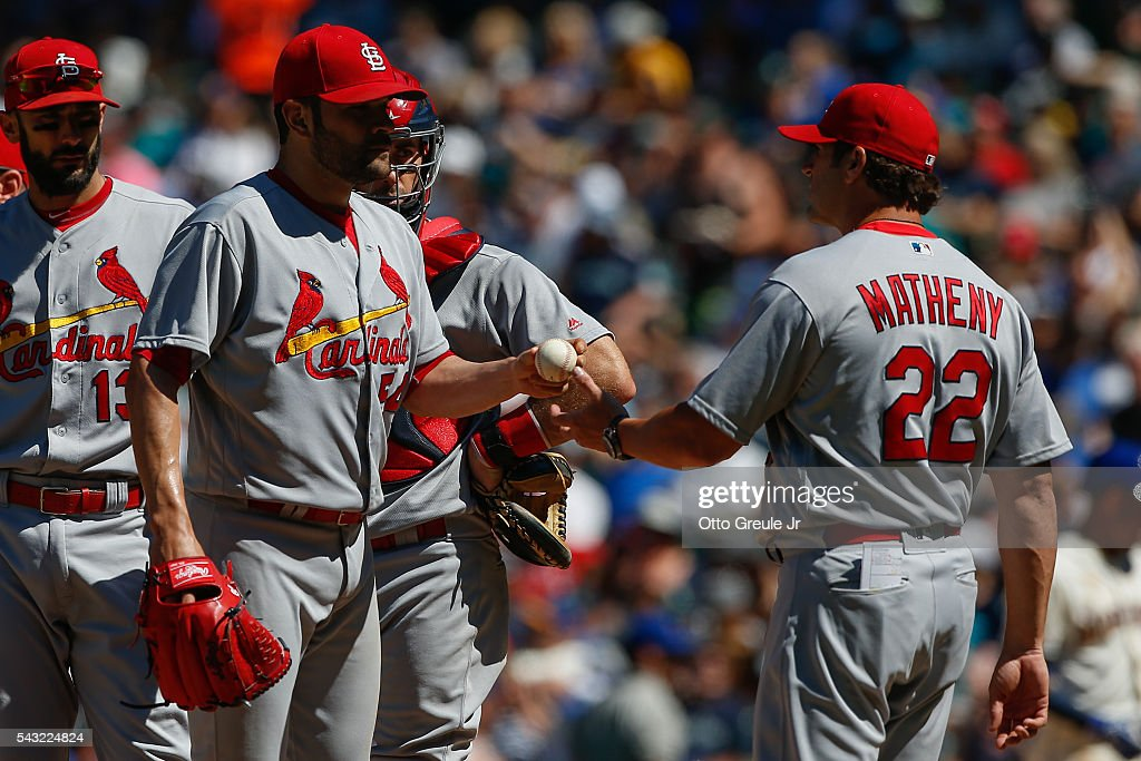 Starting pitcher <a gi-track='captionPersonalityLinkClicked' href=/galleries/search?phrase=Jaime+Garcia+-+Baseball+Player&family=editorial&specificpeople=7620904 ng-click='$event.stopPropagation()'>Jaime Garcia</a> #54 of the St. Louis Cardinals is removed from the game by manager <a gi-track='captionPersonalityLinkClicked' href=/galleries/search?phrase=Mike+Matheny&family=editorial&specificpeople=171706 ng-click='$event.stopPropagation()'>Mike Matheny</a> #22 in the sixth inning against Seattle Mariners at Safeco Field on June 26, 2016 in Seattle, Washington.