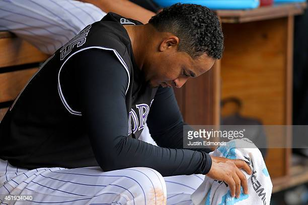 Starting pitcher Jair Jurrjens of the Colorado Rockies sits in the dugout after being pulled from the game in the fifth inning against the San Diego...