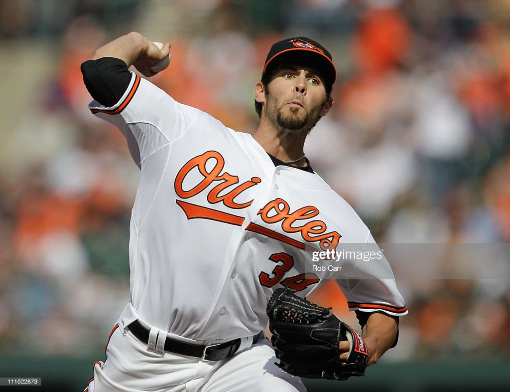 Starting pitcher <a gi-track='captionPersonalityLinkClicked' href=/galleries/search?phrase=Jake+Arrieta&family=editorial&specificpeople=5437045 ng-click='$event.stopPropagation()'>Jake Arrieta</a> #34 of the Baltimore Orioles delivers to a Detroit Tigers batter during the third inning during opening day at Oriole Park at Camden Yards on April 4, 2011 in Baltimore, Maryland.