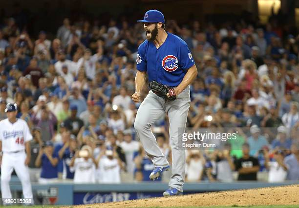 Starting pitcher Jake Arrieta of the Chicago Cubs is surrounded by teammates after getting the final out of a no hitter against the Los Angeles...