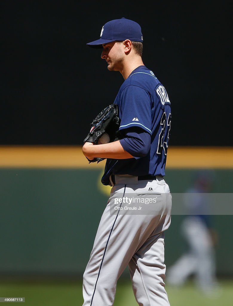 Starting pitcher Jake Odorizzi of the Tampa Bay Rays pauses on the mound after giving up the first hit of the game to James Jones of the Seattle...