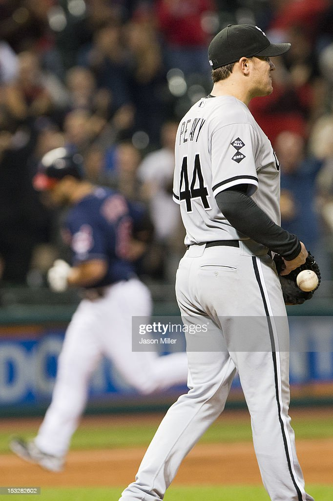 Starting pitcher <a gi-track='captionPersonalityLinkClicked' href=/galleries/search?phrase=Jake+Peavy&family=editorial&specificpeople=211320 ng-click='$event.stopPropagation()'>Jake Peavy</a> #44 of the Chicago White Sox reacts after giving up a two-run home run to <a gi-track='captionPersonalityLinkClicked' href=/galleries/search?phrase=Travis+Hafner&family=editorial&specificpeople=220556 ng-click='$event.stopPropagation()'>Travis Hafner</a> #48 of the Cleveland Indians during the ninth inning at Progressive Field on October 2, 2012 in Cleveland, Ohio.