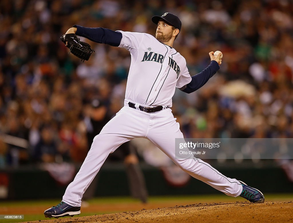Starting pitcher James Paxton #65 of the Seattle Mariners pitches against the Los Angeles Angels of Anaheim on Opening Day at Safeco Field on April 8, 2014 in Seattle, Washington.