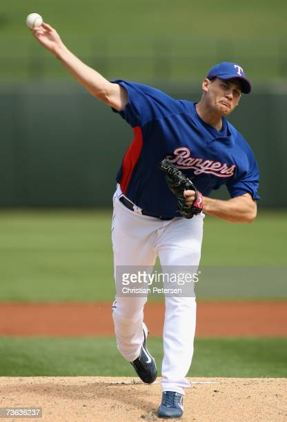 Starting pitcher Jamey Wright of the Texas Rangers pitches during the MLB spring training game against the Seattle Mariners at Surprise Stadium on...