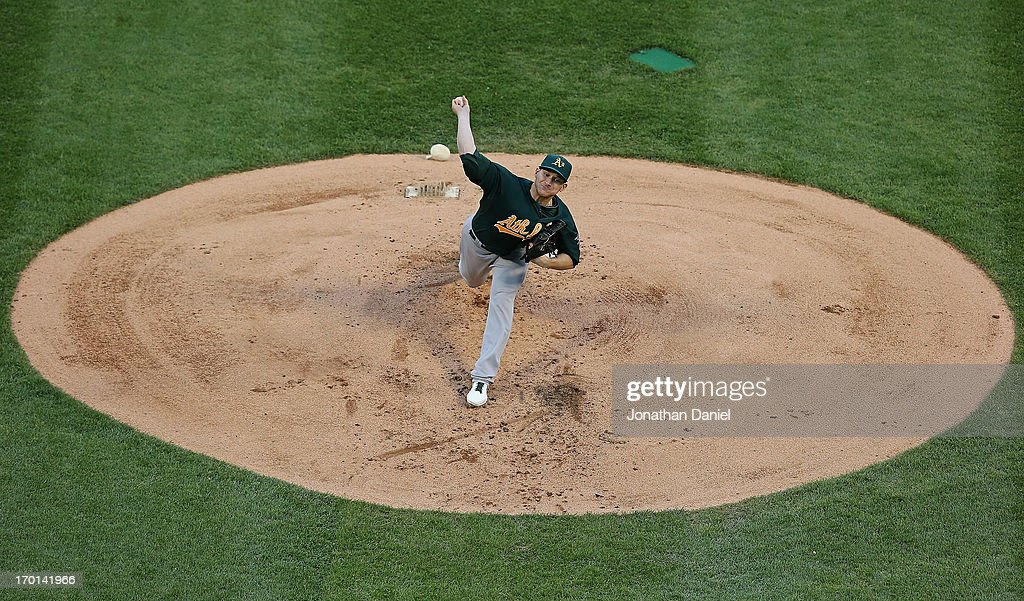 Starting pitcher <a gi-track='captionPersonalityLinkClicked' href=/galleries/search?phrase=Jarrod+Parker&family=editorial&specificpeople=5970942 ng-click='$event.stopPropagation()'>Jarrod Parker</a> #11 of the Oakland Athletics delivers the ball against the Chicago White Sox at U.S. Cellular Field on June 7, 2013 in Chicago, Illinois.