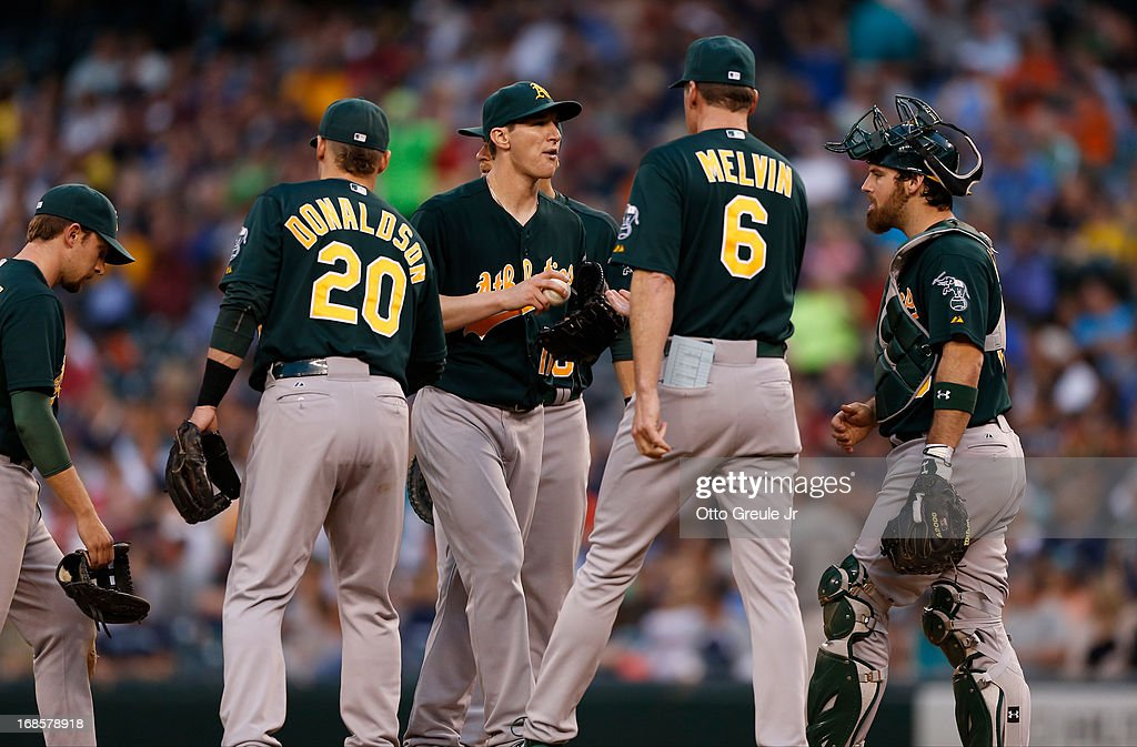 Starting pitcher <a gi-track='captionPersonalityLinkClicked' href=/galleries/search?phrase=Jarrod+Parker&family=editorial&specificpeople=5970942 ng-click='$event.stopPropagation()'>Jarrod Parker</a> #11 of the Oakland Athletics is removed from the game by manager <a gi-track='captionPersonalityLinkClicked' href=/galleries/search?phrase=Bob+Melvin&family=editorial&specificpeople=239192 ng-click='$event.stopPropagation()'>Bob Melvin</a> #6 in the seventh inning against the Seattle Mariners at Safeco Field on May 11, 2013 in Seattle, Washington.