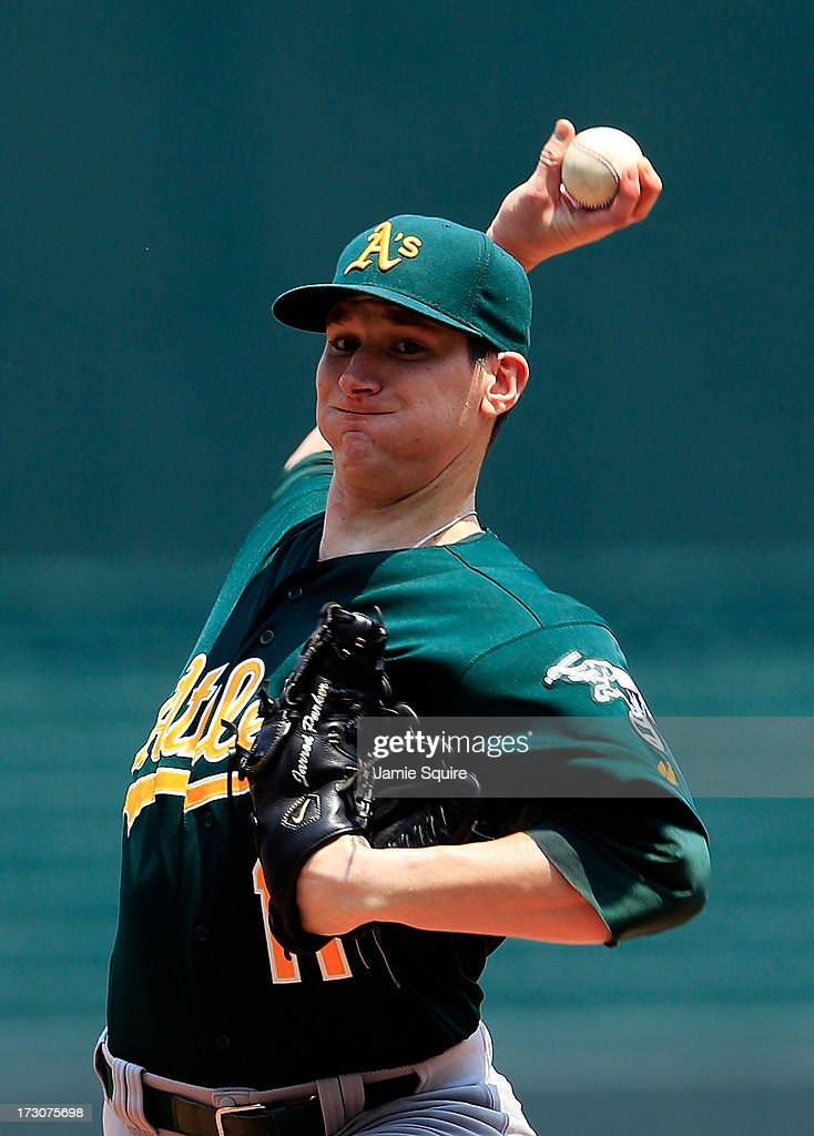 Starting pitcher <a gi-track='captionPersonalityLinkClicked' href=/galleries/search?phrase=Jarrod+Parker&family=editorial&specificpeople=5970942 ng-click='$event.stopPropagation()'>Jarrod Parker</a> #11 of the Oakland Athletics warms up prior to the start of the game against the Kansas City Royals at Kauffman Stadium on July 6, 2013 in Kansas City, Missouri.