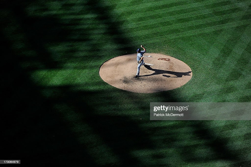 Starting pitcher <a gi-track='captionPersonalityLinkClicked' href=/galleries/search?phrase=Jason+Marquis&family=editorial&specificpeople=210770 ng-click='$event.stopPropagation()'>Jason Marquis</a> #21 of the San Diego Padres throws a pitch against the Washington Nationals during a game at Nationals Park on July 6, 2013 in Washington, DC.