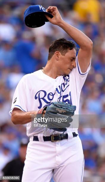 Starting pitcher Jason Vargas of the Kansas City Royals wipes his face after giving up a RBI double to Jose Ramirez of the Cleveland Indians in the...