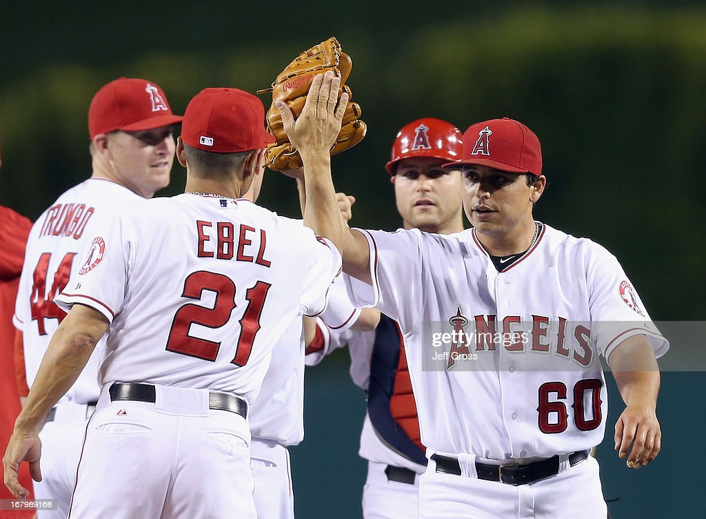 Starting pitcher Jason Vargas #60 of the Los Angeles Angels of Anaheim is congratulated by third base coach Dino Ebel #21 after pitching a shutout against the Baltimore Orioles at Angel Stadium of Anaheim on May 3, 2013 in Anaheim, California. The Angels defeated the Orioles 4-0.