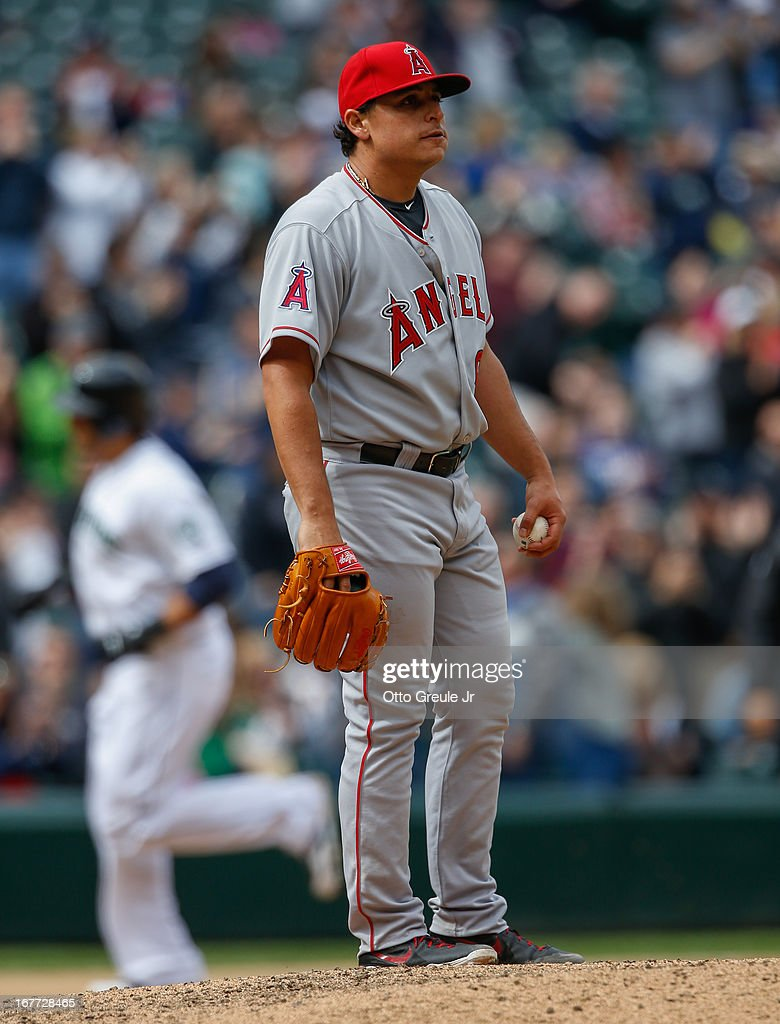 Starting pitcher <a gi-track='captionPersonalityLinkClicked' href=/galleries/search?phrase=Jason+Vargas&family=editorial&specificpeople=640899 ng-click='$event.stopPropagation()'>Jason Vargas</a> #60 of the Los Angeles Angels of Anaheim reacts after giving up a solo home run to Michael Morse #38 of the Seattle Mariners in the eighth inning at Safeco Field on April 28, 2013 in Seattle, Washington. The Mariners defeated the Angels 2-1.