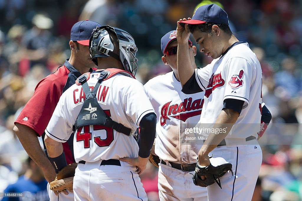 Starting pitcher Jeanmar Gomez #58 talks with his catcher Luke Carlin #45 and pitching coach Scott Radinsky #36 of the Cleveland Indians during the fifth inning against the Kansas City Royals at Progressive Field on May 30, 2012 in Cleveland, Ohio.