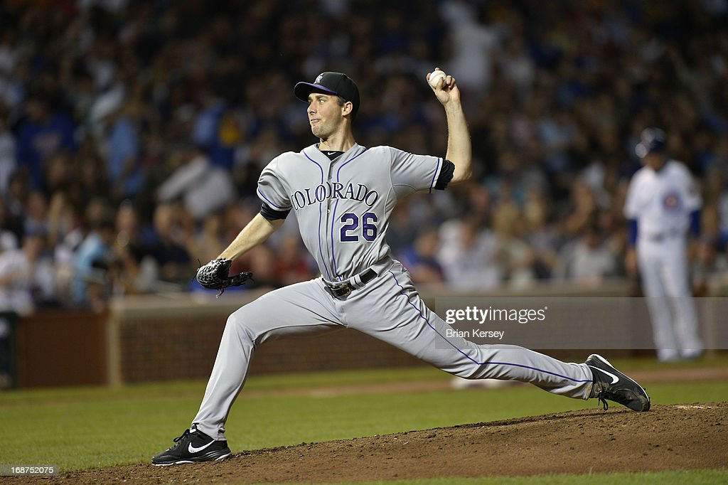 Starting pitcher <a gi-track='captionPersonalityLinkClicked' href=/galleries/search?phrase=Jeff+Francis&family=editorial&specificpeople=220827 ng-click='$event.stopPropagation()'>Jeff Francis</a> #26 of the Colorado Rockies delivers during the fifth inning against the Chicago Cubs on May 14, 2013 at Wrigley Field in Chicago, Illinois.