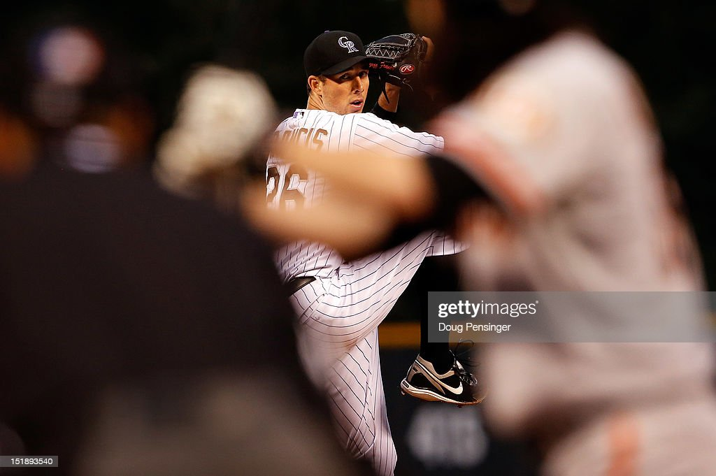 Starting pitcher Jeff Francis of the Colorado Rockies delivers against Tim Lincecum of the San Francisco Giants at Coors Field on September 12 2012...