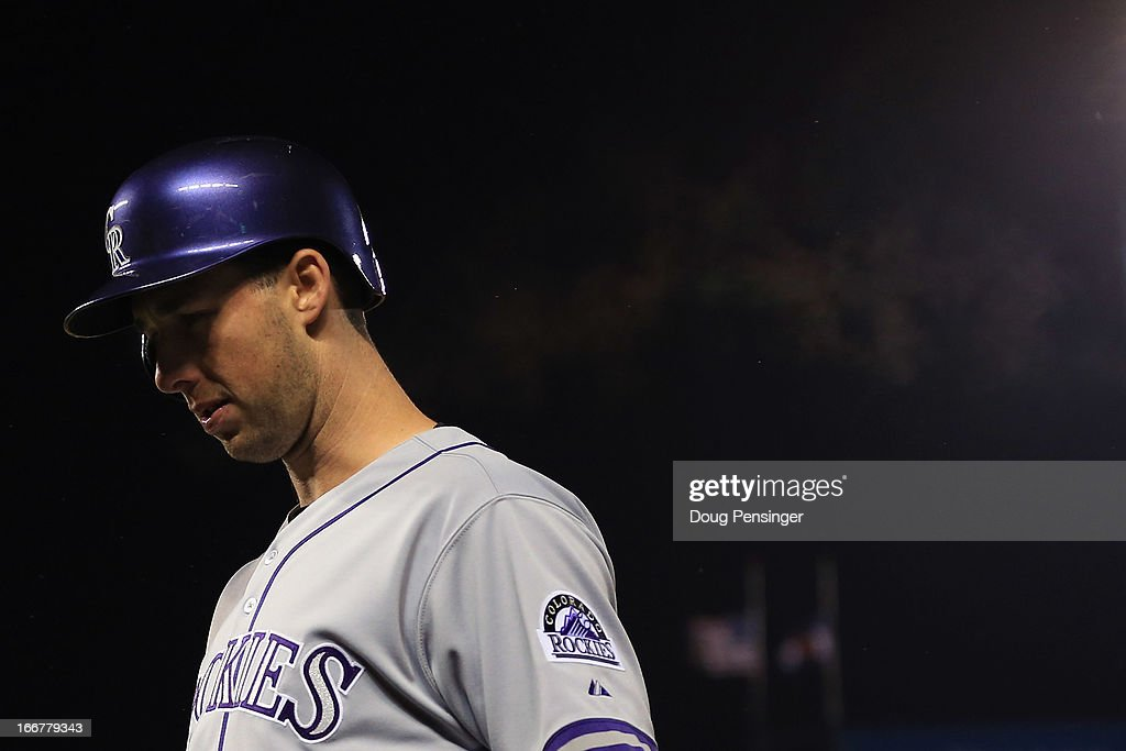 Starting pitcher <a gi-track='captionPersonalityLinkClicked' href=/galleries/search?phrase=Jeff+Francis&family=editorial&specificpeople=220827 ng-click='$event.stopPropagation()'>Jeff Francis</a> #26 of the Colorado Rockies heads to the dugout after bunting into a double play to end the fourth inning against the New York Mets at Coors Field on April 16, 2013 in Denver, Colorado.