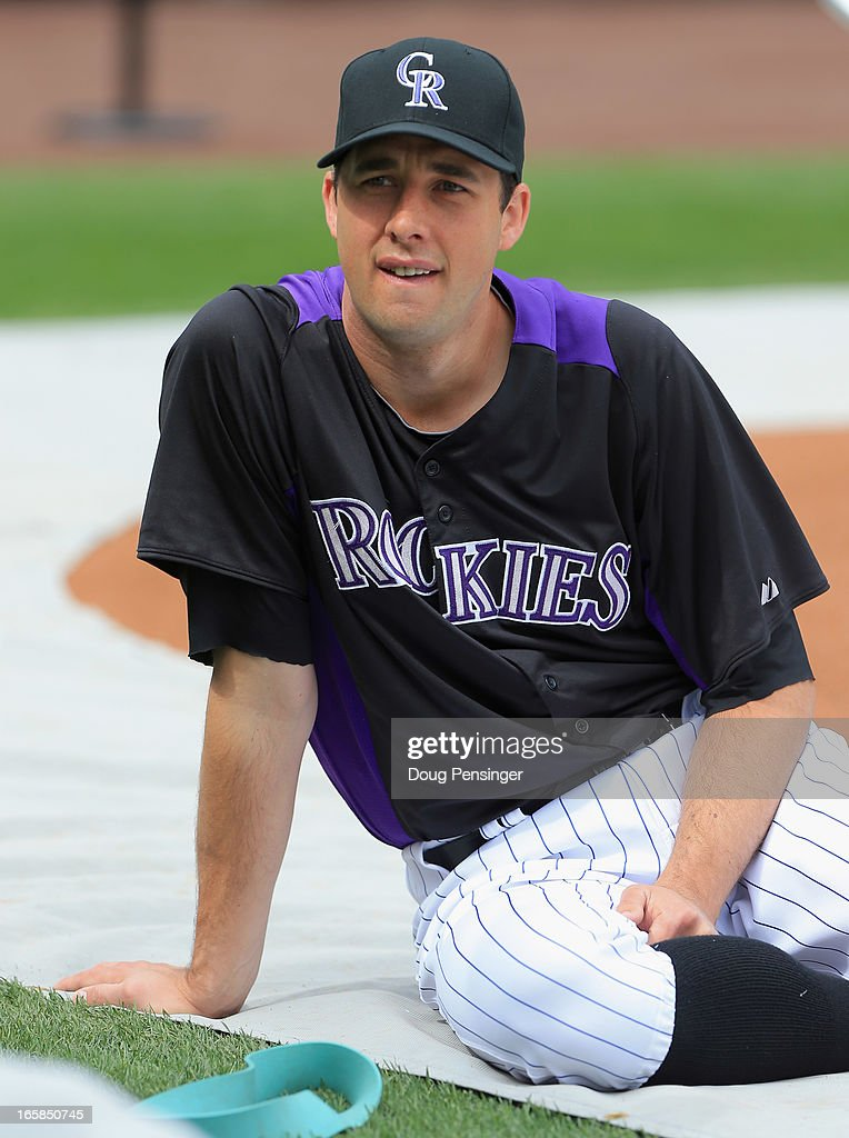 Starting pitcher Jeff Francis of the Colorado Rockies looks on during batting practice prior to facing the San Diego Padres during Opening Day at...