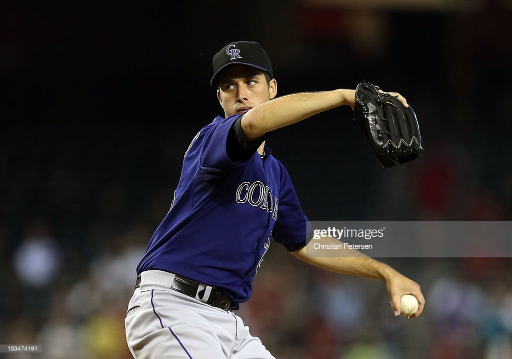 Starting pitcher <a gi-track='captionPersonalityLinkClicked' href=/galleries/search?phrase=Jeff+Francis&family=editorial&specificpeople=220827 ng-click='$event.stopPropagation()'>Jeff Francis</a> #26 of the Colorado Rockies pitches against the Arizona Diamondbacks during the MLB game at Chase Field on October 3, 2012 in Phoenix, Arizona.