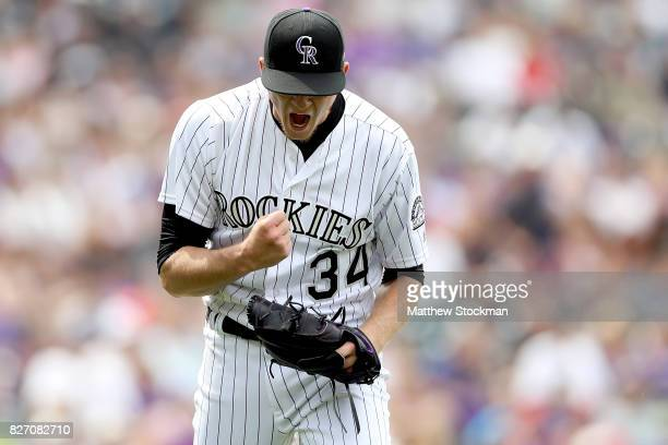 Starting pitcher Jeff Hoffman of the Colorado Rockies celebrates the last out in the top of the seventh inning against the Philadelphia Phillies at...