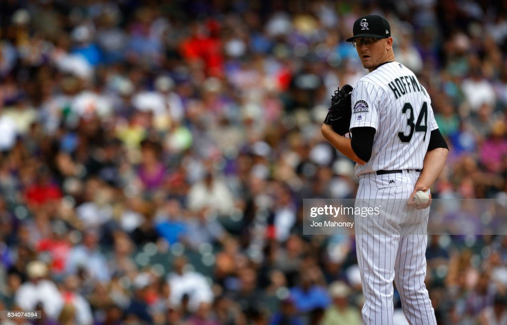 Starting pitcher Jeff Hoffman #34 of the Colorado Rockies looks toward first base in the fourth inning at Coors Field on August 17, 2017 in Denver, Colorado. Atlanta won 10-4.