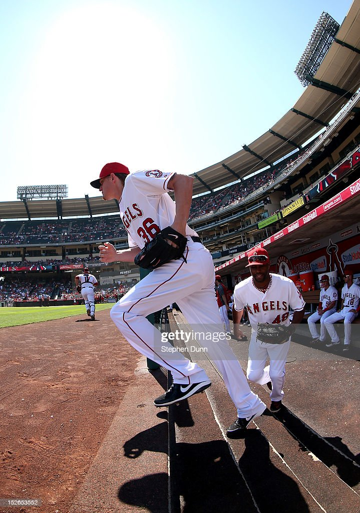 Starting pitcher <a gi-track='captionPersonalityLinkClicked' href=/galleries/search?phrase=Jered+Weaver&family=editorial&specificpeople=565100 ng-click='$event.stopPropagation()'>Jered Weaver</a> #36 and right fielder <a gi-track='captionPersonalityLinkClicked' href=/galleries/search?phrase=Torii+Hunter&family=editorial&specificpeople=183408 ng-click='$event.stopPropagation()'>Torii Hunter</a> #48 of the Los Angeles Angels of Anaheim take the field for the first inning of the game with the Chicago White Sox at Angel Stadium of Anaheim on September 23, 2012 in Anaheim, California. The Angels won 4-1.