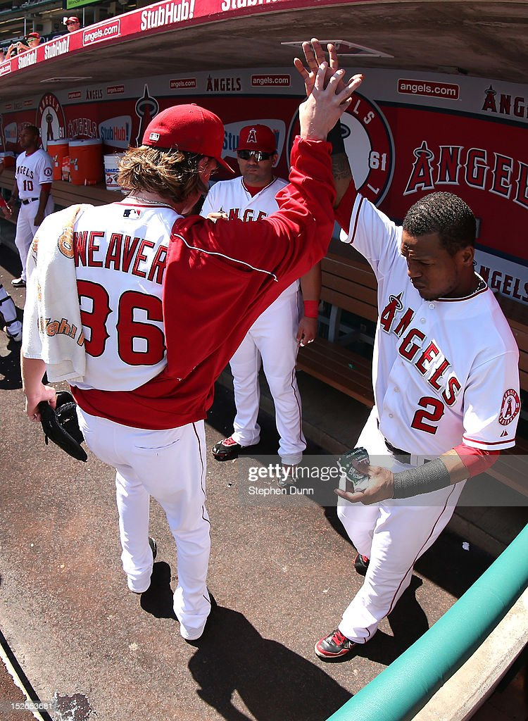 Starting pitcher <a gi-track='captionPersonalityLinkClicked' href=/galleries/search?phrase=Jered+Weaver&family=editorial&specificpeople=565100 ng-click='$event.stopPropagation()'>Jered Weaver</a> #36 and shortstop <a gi-track='captionPersonalityLinkClicked' href=/galleries/search?phrase=Erick+Aybar&family=editorial&specificpeople=551376 ng-click='$event.stopPropagation()'>Erick Aybar</a> #2 of the Los Angeles Angels of Anaheim high five in the dugout before taking the field for the first inning of the game with the Chicago White Sox at Angel Stadium of Anaheim on September 23, 2012 in Anaheim, California. The Angels won 4-1.