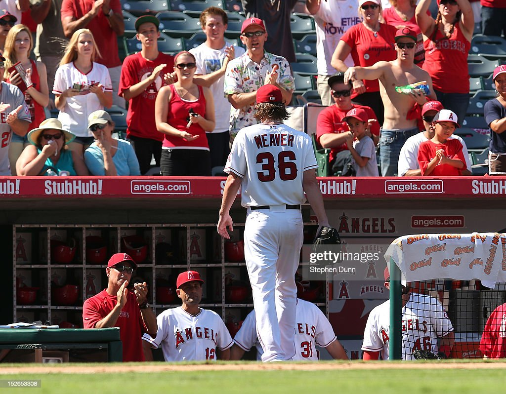 Starting pitcher <a gi-track='captionPersonalityLinkClicked' href=/galleries/search?phrase=Jered+Weaver&family=editorial&specificpeople=565100 ng-click='$event.stopPropagation()'>Jered Weaver</a> #36 of the Los Angeles Angels of Anaheim is greeted by teammates and fans as he walks to the dugout after being relieved in the seventh inning against the Chicago White Sox at Angel Stadium of Anaheim on September 23, 2012 in Anaheim, California. The Angels won 4-1.