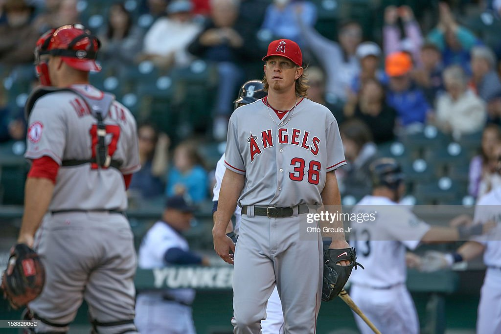 Starting pitcher <a gi-track='captionPersonalityLinkClicked' href=/galleries/search?phrase=Jered+Weaver&family=editorial&specificpeople=565100 ng-click='$event.stopPropagation()'>Jered Weaver</a> #36 of the Los Angeles Angels of Anaheim heads back to the mound after giving up an RBI double to Kyle Seager of the Seattle Mariners in the first inning at Safeco Field on October 3, 2012 in Seattle, Washington. Weaver was removed from the game in the second inning.