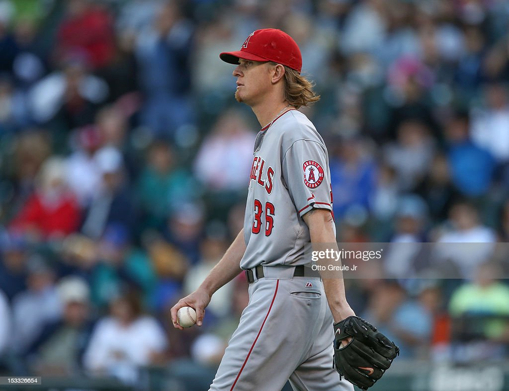 Starting pitcher Jered Weaver #36 of the Los Angeles Angels of Anaheim heads back to the mound after giving up an RBI double to Kyle Seager of the Seattle Mariners in the first inning at Safeco Field on October 3, 2012 in Seattle, Washington. Weaver was removed from the game in the second inning.