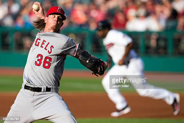 Starting pitcher Jered Weaver of the Los Angeles Angels of Anaheim pitches as Michael Bourn of the Cleveland Indians breaks for second base during...