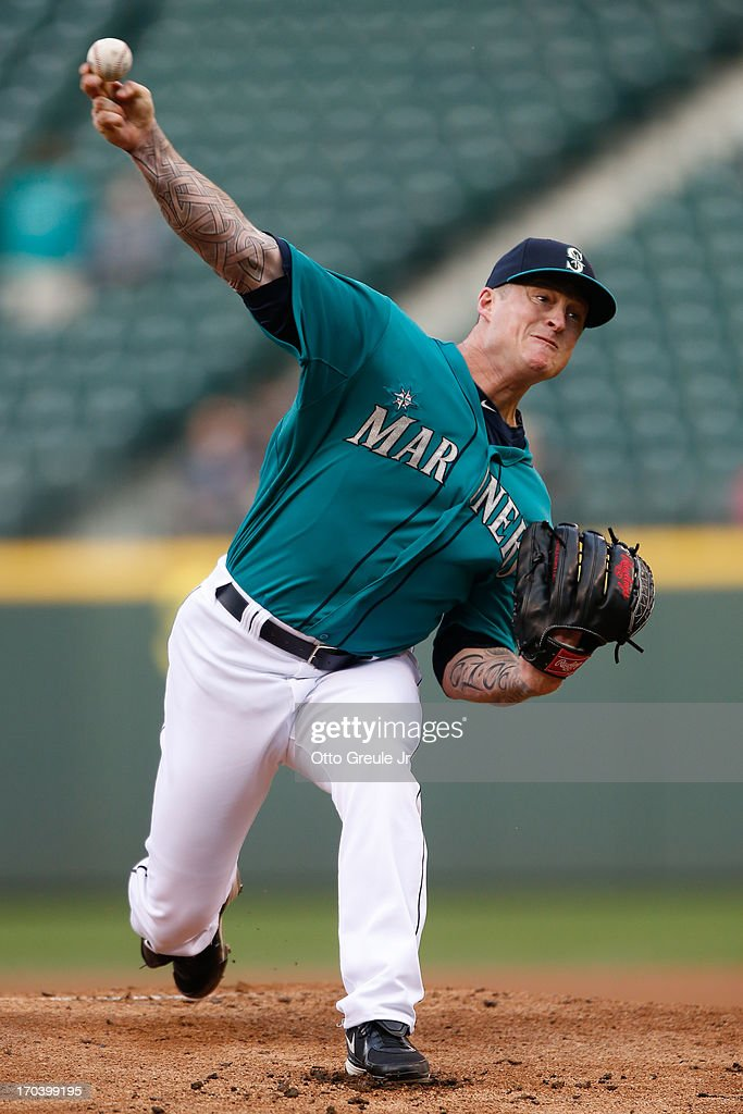 Starting pitcher <a gi-track='captionPersonalityLinkClicked' href=/galleries/search?phrase=Jeremy+Bonderman&family=editorial&specificpeople=207182 ng-click='$event.stopPropagation()'>Jeremy Bonderman</a> #32 of the Seattle Mariners pitches against the Houston Astros at Safeco Field on June 12, 2013 in Seattle, Washington.