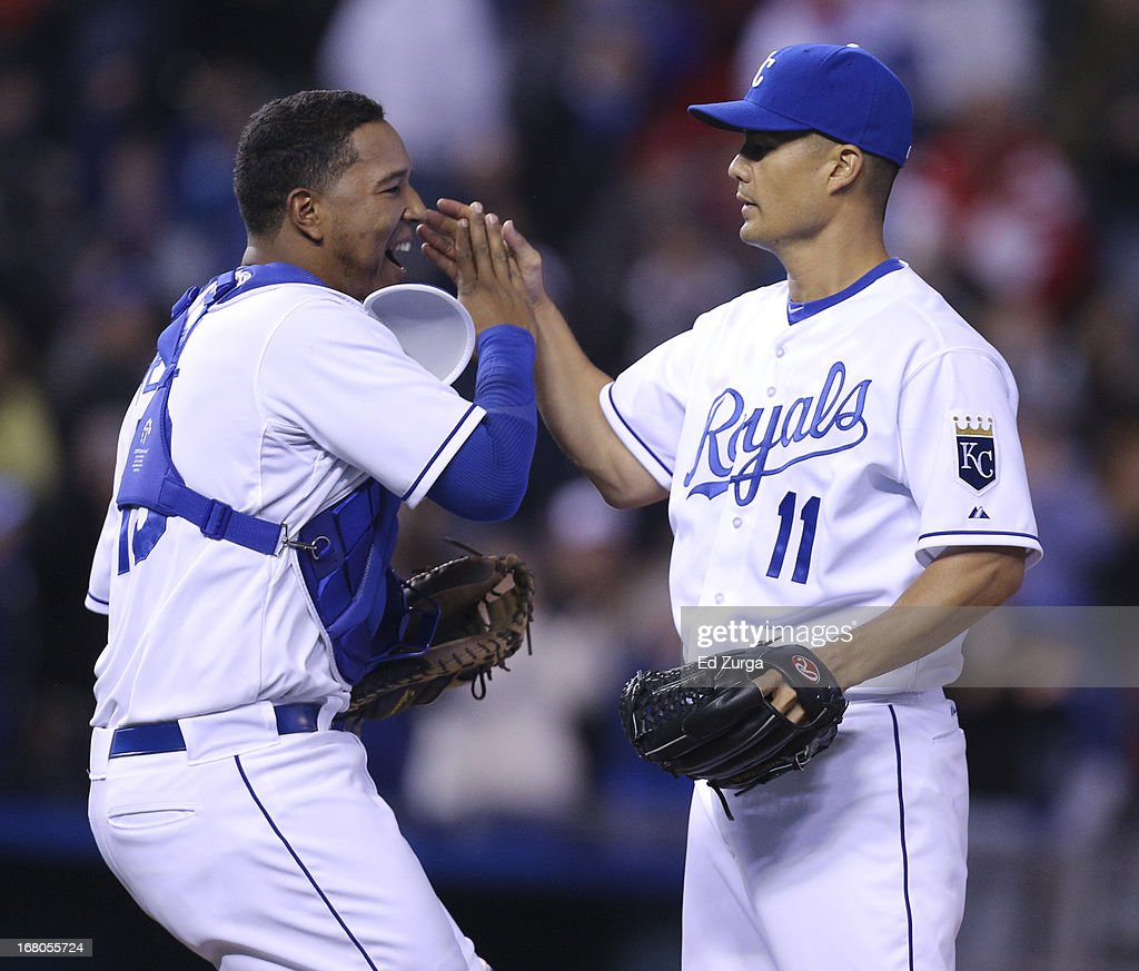 Starting pitcher <a gi-track='captionPersonalityLinkClicked' href=/galleries/search?phrase=Jeremy+Guthrie&family=editorial&specificpeople=650221 ng-click='$event.stopPropagation()'>Jeremy Guthrie</a> #11 of the Kansas City Royals celebrates his complete game shutout against the Chicago White Sox with Salvador Perez #13 at Kauffman Stadium on May 4, 2013 in Kansas City, Missouri. The Royals won 2-0.