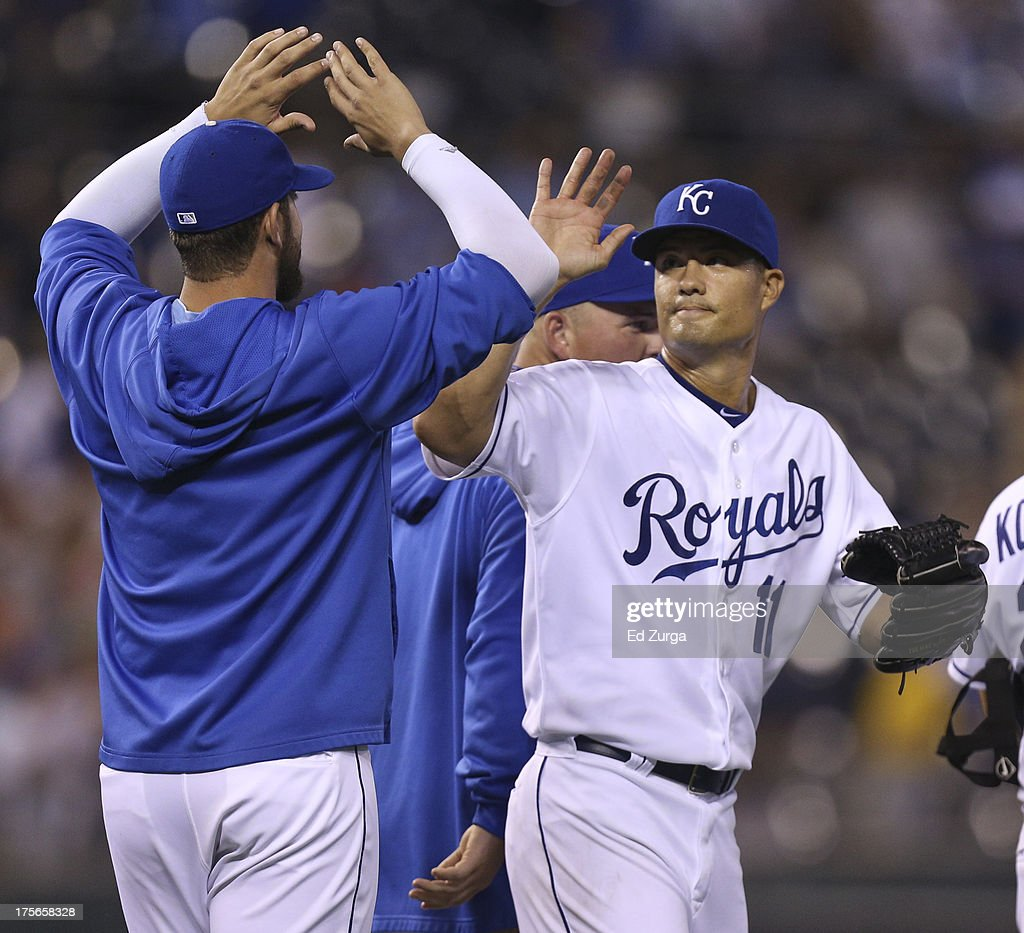 Starting pitcher Jeremy Guthrie #11 of the Kansas City Royals celebrates with James Shields #33 after throwing a complete-game shutout against the Minnesota Twins at Kauffman Stadium August, 5, 2013 in Kansas City, Missouri. The Royals won 13-0.