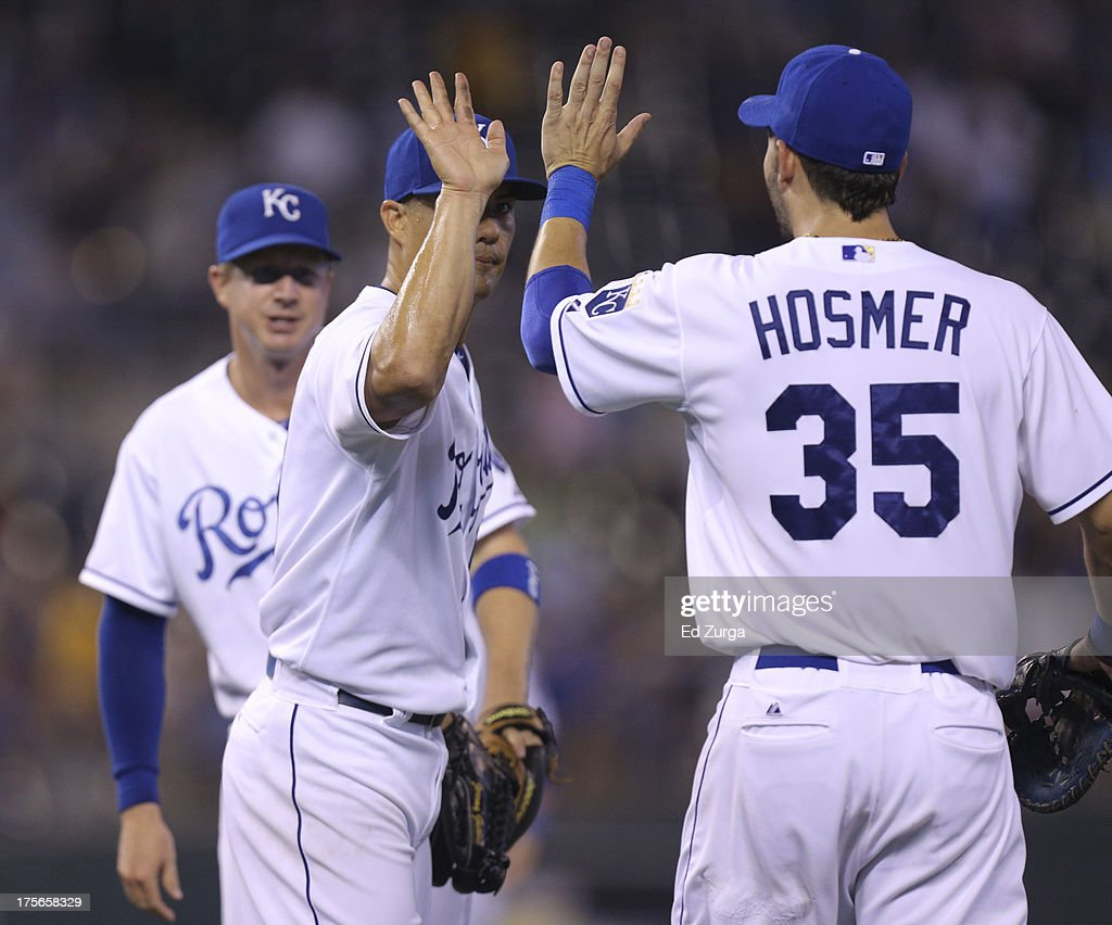 Starting pitcher <a gi-track='captionPersonalityLinkClicked' href=/galleries/search?phrase=Jeremy+Guthrie&family=editorial&specificpeople=650221 ng-click='$event.stopPropagation()'>Jeremy Guthrie</a> #11 of the Kansas City Royals celebrates with <a gi-track='captionPersonalityLinkClicked' href=/galleries/search?phrase=Eric+Hosmer&family=editorial&specificpeople=7091345 ng-click='$event.stopPropagation()'>Eric Hosmer</a> #35 after throwing a complete-game shutout against the Minnesota Twins at Kauffman Stadium August, 5, 2013 in Kansas City, Missouri. The Royals won 13-0.