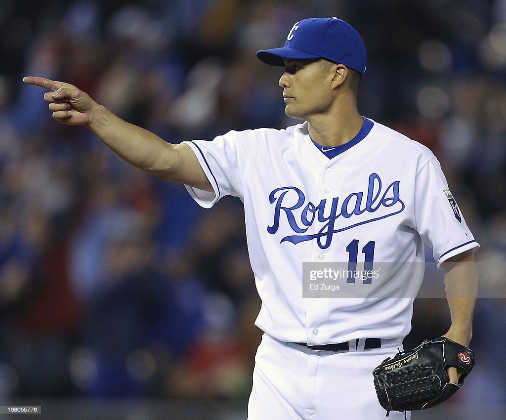 Starting pitcher <a gi-track='captionPersonalityLinkClicked' href=/galleries/search?phrase=Jeremy+Guthrie&family=editorial&specificpeople=650221 ng-click='$event.stopPropagation()'>Jeremy Guthrie</a> #11 of the Kansas City Royals points to catcher Salvador Perez after throwing a complete game shutout against the Chicago White Sox at Kauffman Stadium on May 4, 2013 in Kansas City, Missouri.