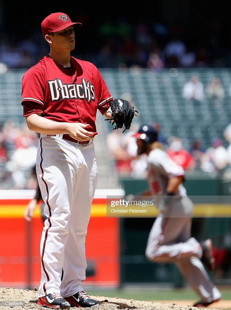Starting pitcher <a gi-track='captionPersonalityLinkClicked' href=/galleries/search?phrase=Jeremy+Hellickson&family=editorial&specificpeople=2364859 ng-click='$event.stopPropagation()'>Jeremy Hellickson</a> #58 of the Arizona Diamondbacks reacts after giving up a three run home-run to <a gi-track='captionPersonalityLinkClicked' href=/galleries/search?phrase=Bryce+Harper&family=editorial&specificpeople=5926486 ng-click='$event.stopPropagation()'>Bryce Harper</a> #34 of the Washington Nationals during the MLB game at Chase Field on May 13, 2015 in Phoenix, Arizona.