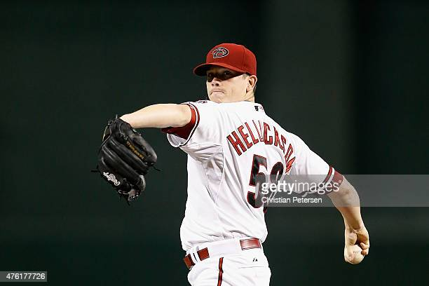 Starting pitcher Jeremy Hellickson of the Arizona Diamondbacks throws a pitch in between innings of the MLB game against the New York Mets at Chase...