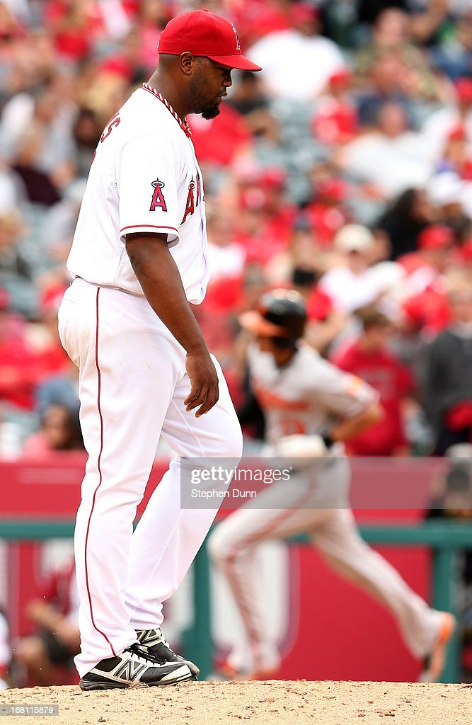 Starting pitcher <a gi-track='captionPersonalityLinkClicked' href=/galleries/search?phrase=Jerome+Williams+-+Baseball+Player&family=editorial&specificpeople=15260950 ng-click='$event.stopPropagation()'>Jerome Williams</a> #57 of the Los Angeles Angels of Anaheim reacts as <a gi-track='captionPersonalityLinkClicked' href=/galleries/search?phrase=Manny+Machado&family=editorial&specificpeople=5591039 ng-click='$event.stopPropagation()'>Manny Machado</a> #13 of the Baltimore Orioles circles the bases after hitting a two run home run in the fifth inning at Angel Stadium of Anaheim on May 5, 2013 in Anaheim, California.
