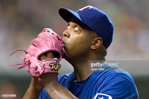 Starting pitcher Jerome Williams of the Texas Rangers reacts after leaving the game during the fifth inning against the Cleveland Indians at...