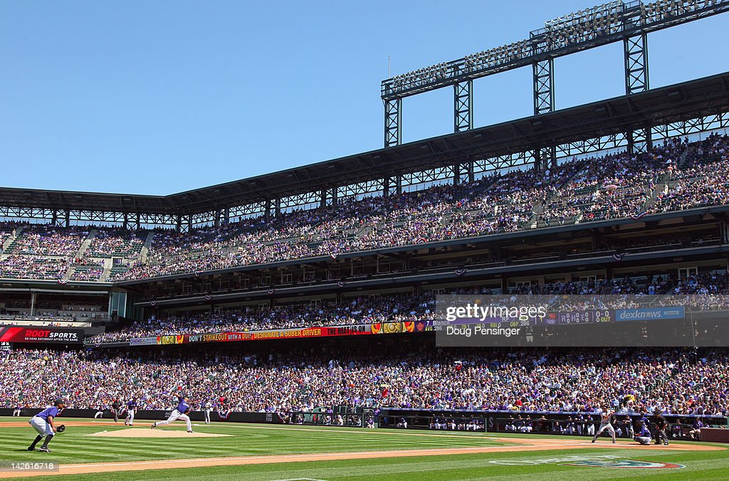 Starting pitcher Jhoulys Chacin of the Colorado Rockies delivers the first pitch of the game to Gregor Blanco of the San Francisco Giants on Opening...